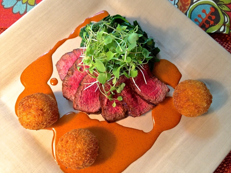 filet-mignon-medallions-with-red-chile-porcini-cream-croquettes-of-yukon-gold-potatoes-roasted-green-chile-and-goat-cheese-and-butter-glazed-spinach-and-arugula