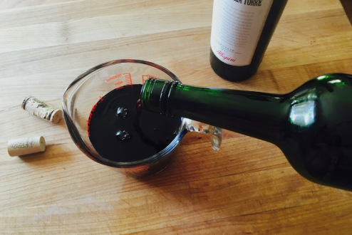 pouring-wine-and-port-into-measuring-cup